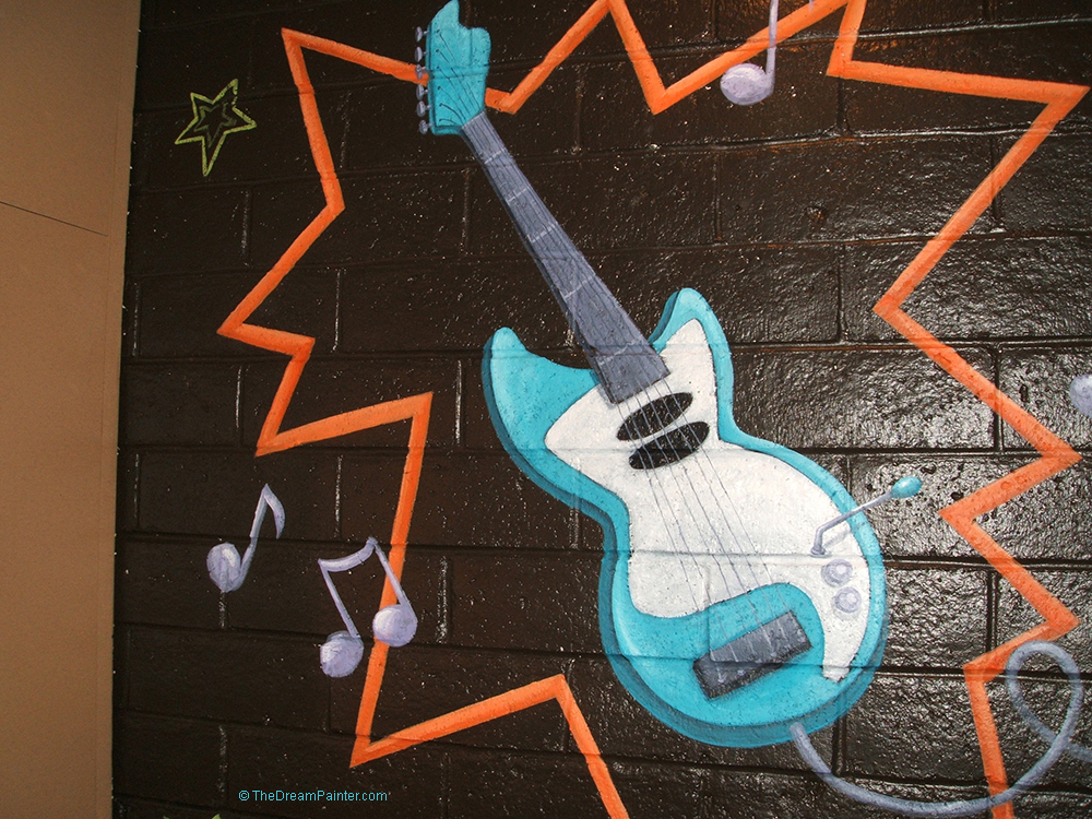 Rock N Roll Bathroom mural with electric guitar, drums, and microphone